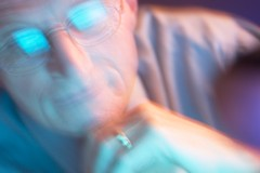 A blurry image of a man, as if having a seizure