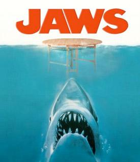 A large shark eats a wooden table